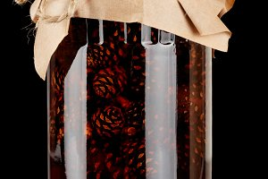 Glass jar with pine cones preserves