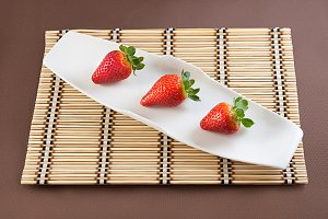 Strawberries on table mat