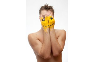 Man with smile face mask