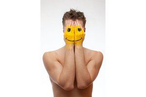 Man hide under smile mask
