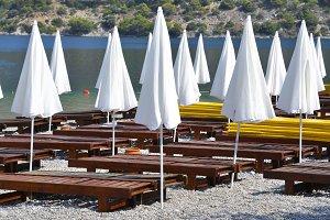 White parasols on the beach