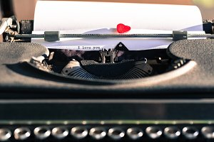 Old typewriter with words of love