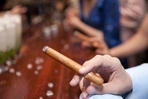 Man smoking cigar, shallow focus