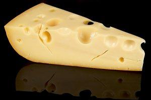 Piece of ripened swiss cheese