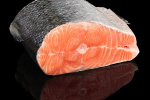 Piece of salmon isolated on black