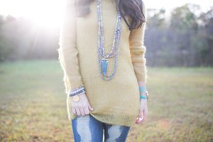 Woman Outside in Yellow Sweater