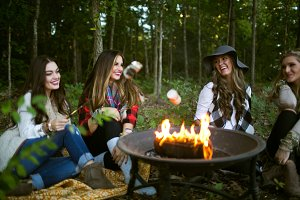 4 Women Roasting Marshmallows