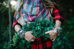 Woman in Plaid Holding Wreath