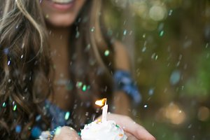 Woman Holding Cupcake in Confetti