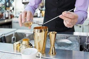 Bartender is adding an ingredient