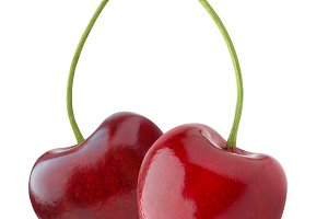 Two heart-shaped cherries isolated