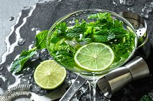Cocktail drink with lime, mint, ice