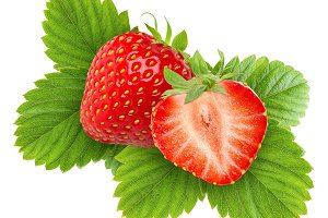 Two cut strawberries on leaves