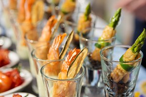 Glasses with seafood snacks
