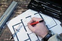 Architect draws a draft.
