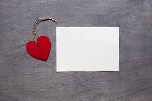 Invitation card with red heart