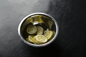 Metal Bowl of Sliced Pickles