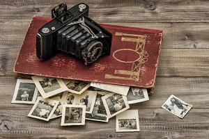 Antique film camera, photo album