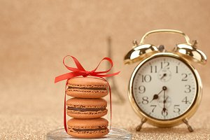 Macarons. Gold alarm clock,breakfast
