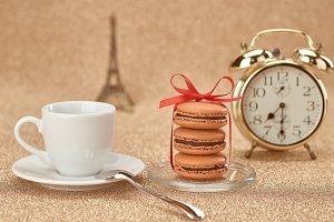 Macarons,cup coffee,gold alarm.Love