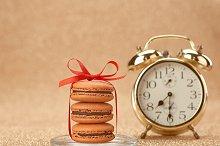 Macarons. Gold alarm clock,breakfast