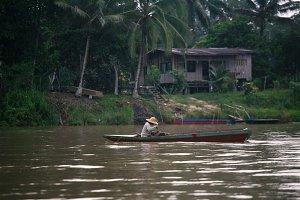 Man in the Boat,Borneo,Malaysia