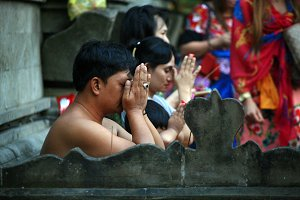 Balinese people praying in a Temple