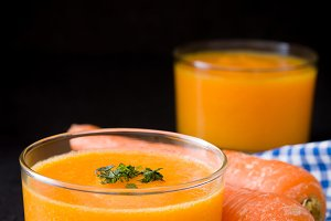 Orange smoothie. Black background