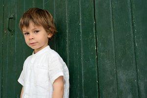 Boy in green door
