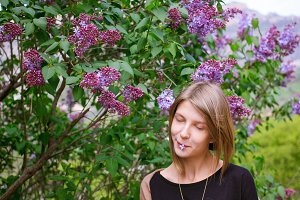 spring girl enjoyed lilac