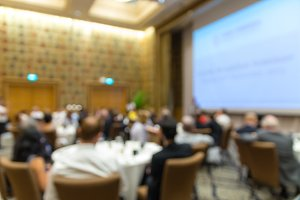 Abstract blurred photo of conference