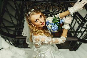Stylish happy bride with flowers