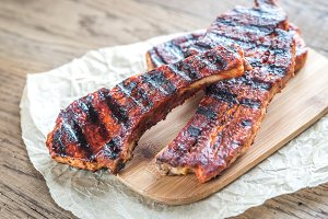 Grilled pork ribs on wooden board