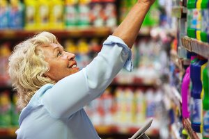 Woman buying household detergents