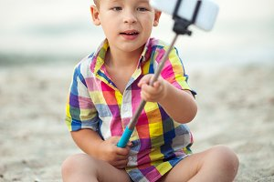 Child with phone and selfie