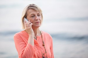 Blond woman having a phone
