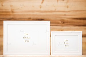 White frames on wood background