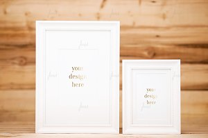 Styled white frames wood background