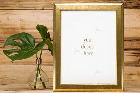 Frame with monstera deliciosa leaves