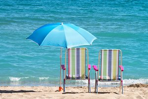 sunbeds and umbrella in the beach
