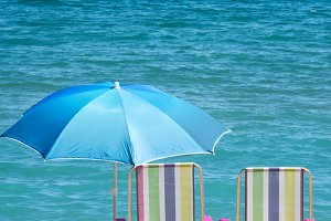 sunbeds and umbrella on the beach