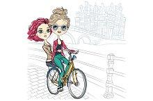 Cute girls ride a bike