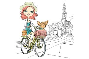 Girl with dog rides a bike