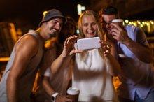 Happy friends making phone selfie