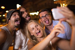 Young people taking crazy selfie