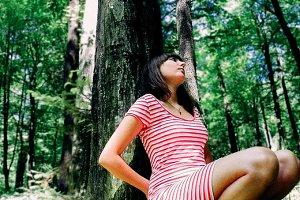 brunette woman in forest