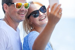Cheerful couple in sunglasses