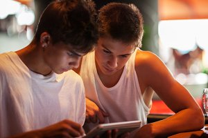 Young men using tablet computer