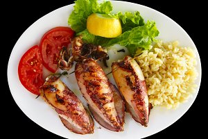 Grilled stuffed squids with rice