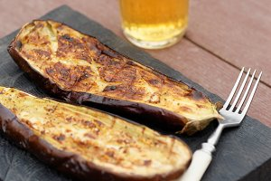 Grilled eggplant on cutting board